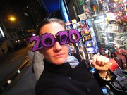 "A woman tries on a pair of 2010 glasses on sale in New York City. Many people doubted that the popular New Year's Eve eyewear would survive after the convenient double zeroes gave way to a number with ""1"" in the third position. But spectacle makers took on the challenge with varying — and mostly symmetrical — results."