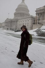 Sen. Lisa Murkowski, R-Alaska, leaves the Senate on Saturday in the snow following an early morning vote on Capitol Hill in Washington. Senators have been working odd hours lately, but the job has its perks.
