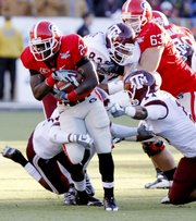 Georgia tailback Washaun Ealey (24) runs past Texas A&M defenders. Ealey ran for 78 yards in the Bulldogs' 44-20 Independence Bowl victory against Texas A&M on Monday in Shreveport, La.