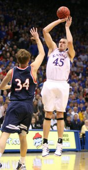 Kansas center Cole Aldrich pulls up for a jumper over Belmont forward Mitch Hedgepeth during the first half, Tuesday, Dec. 29, 2009 at Allen Fieldhouse.