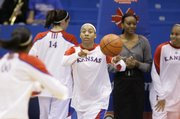 Kansas forward Aishah Sutherland moves the ball around during warmups prior to tipoff against Pepperdine, Wednesday, Dec. 30, 2009 at Allen Fieldhouse.