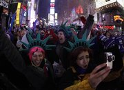 Revelers celebrate the New Year at the stroke of midnight Friday in New York's Times Square. Leaders around the world expressed hope that the new year would be a time of renewal after a decade of war, recession, terrorism and threats of environmental catastrophe.