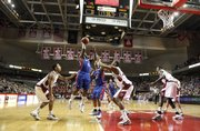 Kansas guard Sherron Collins hangs for a shot over the Temple defense during the first half, Saturday, Jan. 2, 2010 at the Liacouras Center in Philadelphia, Pa.