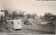 The parked trailers of Sunflower Ordnance Works employees are shown a block south of De Soto's downtown in this photo from November 1942. Many families lived in tents, some workers slept on mattresses in the open, and other men rented sleeping quarters on a schedule that corresponded to Sunflower shift changes.