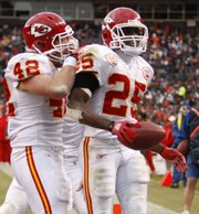Kansas City running back Jamaal Charles (25) is congratulated by Mike Cox after Charles' third-quarter touchdown. Charles rushed for 259 yards in the Chiefs' 44-24 victory over the Broncos on Sunday in Denver.