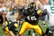 Iowa's Christian Ballard (46) protects a kick during a field-goal attempt against Michigan State in this photo from 2007. Ballard, a Free State High graduate, will play in the Orange Bowl tonight against Georgia Tech.