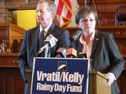 "State Sens. John Vratil, R-Leawood, and Laura Kelly, D-Topeka, hold a news conference Tuesday in the Senate chamber to propose a constitutional amendment that would set up a ""Rainy Day Fund"" where some tax monies would be held back from spending in good economic years, and then could be spent during lean times, such as now."