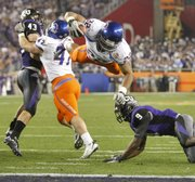 Boise State running back Doug Martin (22) leaps past TCU safety Alex Ibiloye (9) into the end zone during the fourth quarter of the Fiesta Bowl. Boise State won, 17-10, on Monday in Glendale, Ariz.