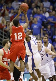 Louis Dale puts up a three pointer over Kansas guard Tyshawn Taylor during the first half, Wednesday, Jan. 6, 2009 at Allen Fieldhouse.