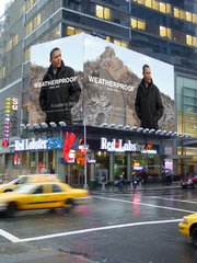 A Times Square billboard shows President Obama wearing one of their coats while in China in this photo released by AP Images and Weatherproof Garment Company.