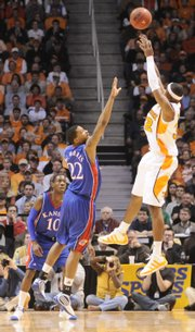 Kansas forward Marcus Morris steps out to defend a shot from Tennessee guard Scotty Hopson during the first half Sunday, Jan. 10, 2009 at Thompson-Boling Arena in Knoxville.