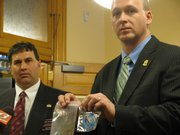 State Rep. Rob Olson (left) and Johnson County forensic scientist Jeremy Morris in January 2010 display the K2 product that they want banned because it contains synthetic substances that mimic the effects of marijuana. Olson, R-Olathe, and Johnson County law officers held a news conference at the Statehouse on the first day of the 2010 legislative session.