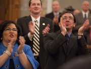 Before the state of the state address, Rep. Tony Brown, D-Baldwin City, right,  and other members applaud during introductions inside the House Chambers in Topeka Monday, Jan. 11, 2010.