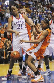Kansas forward Carolyn Davis (21) fights Oklahoma State's Precious Robinson (24) for a loose ball Tuesday Jan. 12, 2010 at Allen Fieldhouse.