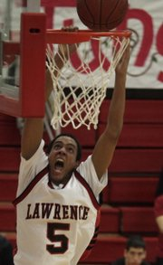 LHS senior Marcus Ray dunks in the first half of the Lawrence boys' game against Shawnee Mission North  Tuesday, Jan. 12, 2010.