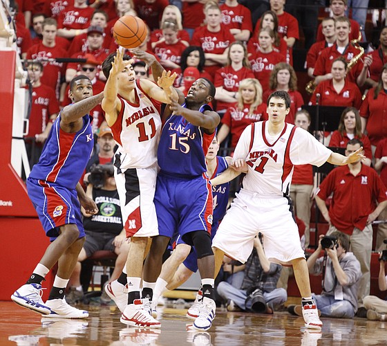 Kansas defenders Thomas Robinson, left, and Elijah Johnson pressure Nebraska forward Christian Standhardinger during the first half Wednesday, Jan. 13, 2009 at the Devaney Center in Lincoln, Nebraska.