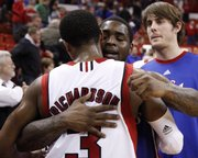 Kansas guard Sherron Collins hugs Nebraska guard Brandon Richardson following the Jayhawks' 84-72 win over the Huskers, Wednesday, Jan. 13, 2010 at the Devaney Center in Lincoln, Nebraska.