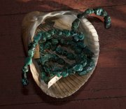 A Loose bead turquoise necklace is displayed in a clam shell at Blackbird Trading Post, 8 W. Ninth St.