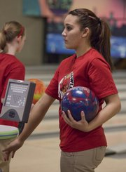 Lawrence senior Alexah Gudenkauf dries her hands as she waits her turn to bowl.