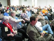 Crowd at the Dillon House on Friday in Topeka listens to speakers. The all-Republican lineup of speakers denounced the Democratic administration. Earlier in the day, a committee hearing was held on a resolution telling the federal government to stop intruding in the business of states. No action was taken on the measure.