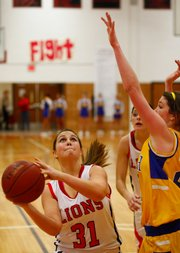 Lawrence's Abbie Ramos (31) looks to the hoop during the game against Olathe South on Friday, Jan. 15, 2010, at LHS.