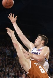 Nick Collison unrolls a shot over UT's Brad Buckman.