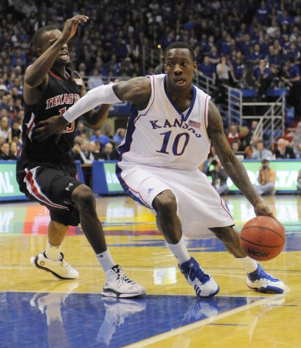 Kansas guard Tyshawn Taylor drives around Texas Tech's David Tairu Saturday, Jan. 16, 2010 at Allen Fieldhouse.