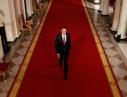 President Barack Obama walks down the Cross Hall of the White House in Washington, to hold his first news conference, Feb. 9, 2009, in the East Room. Obama enters his second year in office leading a country struggling to find its footing.