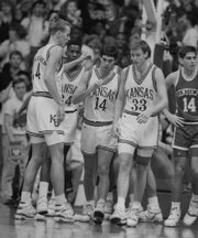 KU players gather on the court during KU's 150-95 blowout of Rick Pitino's Kentucky Wildcats in December, 1989. From left are Pekka Markkanen, Freeman West, Kevin Prichard and Jeff Gueldner. Seven KU players scored in double figures.