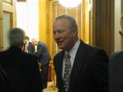 Former Oklahoma University football coach Barry Switzer was in the Statehouse on Wednesday talking to the Senate Transportation Committee as a representative of a company that provides insurance status verification.