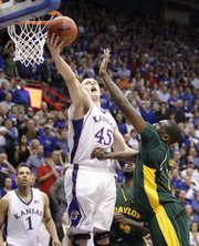 Kansas center Cole Aldrich rips a rebound away from Baylor center Ekpe Udoh during the second half, Wednesday, Jan. 20, 2010 at Allen Fieldhouse.