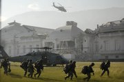 A U.S. Navy helicopter takes off Tuesday in front of the National Palace after members of the U.S. Army 82nd Airborne, front, landed in Port-au-Prince. U.S. Navy helicopters touched down on the grounds of Haiti's damaged presidential palace bringing reinforcements in the struggle for security and earthquake disaster relief.