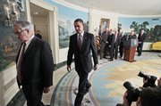 President Barack Obama follows House Financial Service Committee Chairman Rep. Barney Frank, D-Mass., after the president spoke about financial reform Thursday at the White House in Washington.