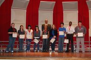 The top three students from each class are pictured in order from left to right: Hannah Novinger, ninth grade; Sadie Keller, seventh grade; Maria Najarro, ninth grade; Ruby Love, eighth grade; Traci Dotson, eighth grade; Rececca Neuhaus, seventh grade; Tommy Finch, seventh grade; Charles Hopkins, ninth grade, and Reid Buckingham, seventh grade. Former Kansas University men's basketball player Bud Stallworth is pictured in the back row.