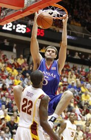 Kansas center Jeff Withey delivers a dunk before Iowa State forward LaRon Dendy during the second half, Saturday, Jan. 23, 2010 at Hilton Coliseum in Ames, Iowa.