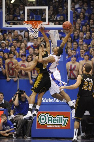 Kansas forward Marcus Morris goes up for a dunk over Missouri's Keith Ramsey Monday, Jan. 25, 2010 at Allen Fieldhouse.
