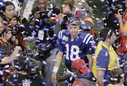 Indianapolis quarterback Peyton Manning (18) walks on the field after the Colts beat the Jets in the AFC championship game. Indianapolis beat New York, 30-17, on Sunday in Indianapolis.