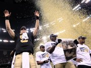 New Orleans quarterback Drew Brees (9) celebrates after the Saints beat the Vikings in the NFC championship game. The Saints won, 31-28 in overtime, on Sunday in New Orleans.