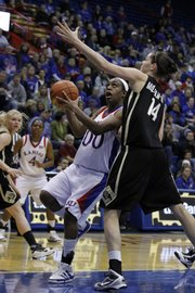 Kansas senior LaChelda Jacobs (00) drives to the basket in the first half, Wednesday, Jan. 27, 2010 at Allen Fieldhouse.