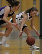 Senior Susan Wilson (right) scrambles for a loose ball in second half action of the Free State and Topeka West gamein the Firebird Winter Classic Thursday, Jan. 28, 2010.