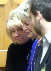Jeanne Tiller, center, cries Friday in the courtroom as Scott Roeder is found guilty of premeditated, first-degree murder in the May 31 shooting death of her husband, Dr. George Tiller. Others in the photo are unidentified.