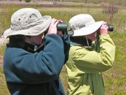 Kelly Barth, foreground, and Lisa Grossman bird-watch at the Baker Wetlands.