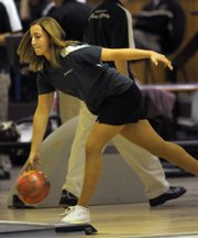 Free State's Christina Picicci bowls during the Firebirds' match with Kansas City Turner. Picicci rolled a 679 series, and both the FSHS girls and boys defeated Turner on Tuesday at Royal Crest Lanes.