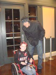 Wellsville resident Michael Douglas, 11, is pictured with Nick Collison, a former Kansas University player, who is a member of Oklahoma City Thunder. Michael attended the Jan. 16 game between the Thunder and Miami Heat in Oklahoma City. The Thunder won 98-80.