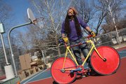 Malakai Edison of Lawrence prepares for a Scary Larry Bike Polo match at Veterans Park, 19th and Louisiana St. Edison, an AmeriCorps volunteer at Van Go Mobile Arts, is one of three regional reps for the North American Hardcourt Bike Polo league.
