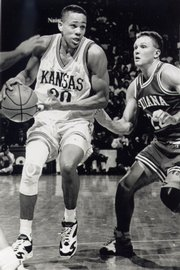 Kansas star Steve Woodberry drives for a shot against Indiana.