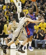 Kansas guard Sherron Collins pushes the ball up court as he is pressured by Colorado guard Nate Tomlinson during the first half Wednesday, Feb. 3, 2010 at the Coors Event Center in Boulder.