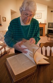 Beverly Burrows has a very large, ten-pound family bible. The pages sometimes make it hard to turn.