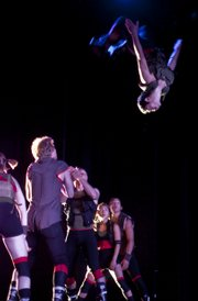 Jun Kuribayashi flips in the air during a Pilobolus performance at the Joyce Theater in New York City.
