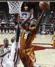 Texas guard Damion James, right, shoots in front of Oklahoma forward Ryan Wright during their game Saturday in Norman, Okla. James leads the Longhorns into today's Big Monday game against Kansas.
